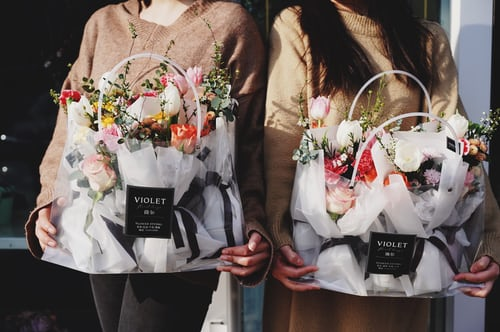 Two girls holding Bouquet baskets