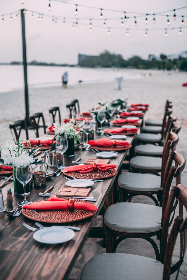 A beautiful seating arrangement for a meal by the beach