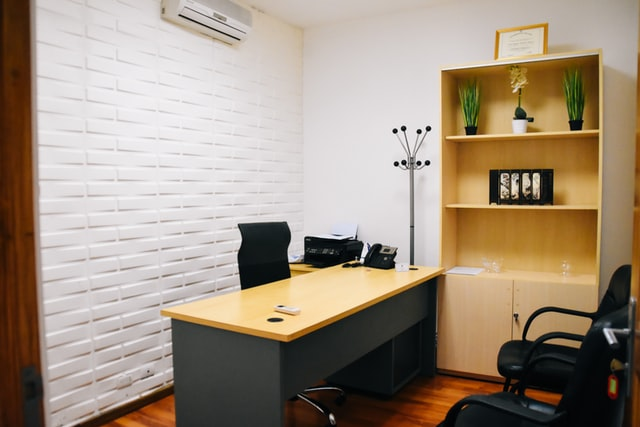 Chair and Book shelve in an office