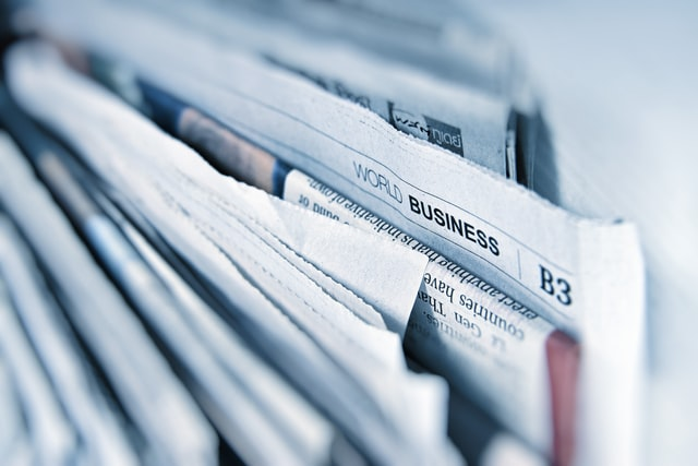 Pile of business newspapers