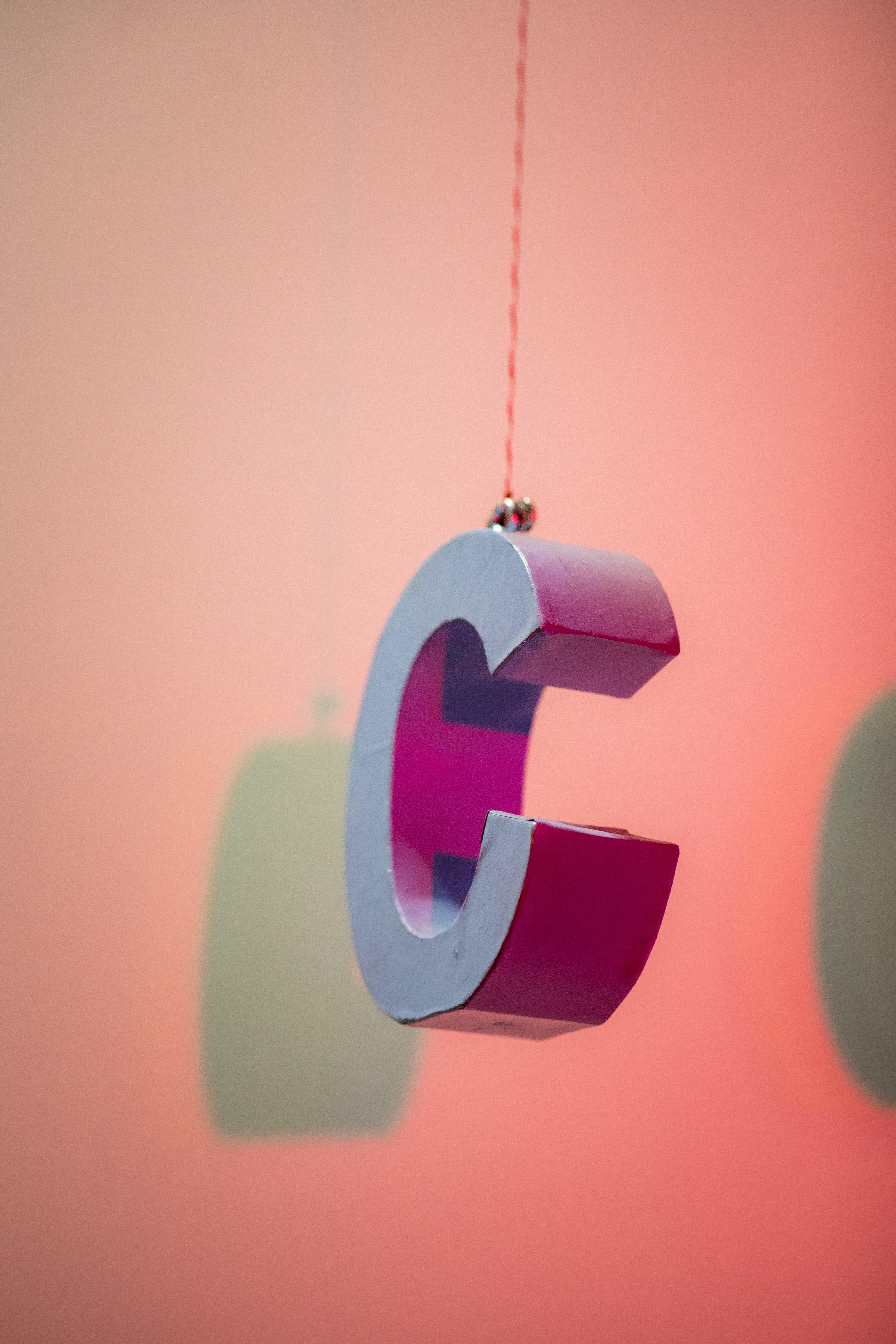 Pink logo of company