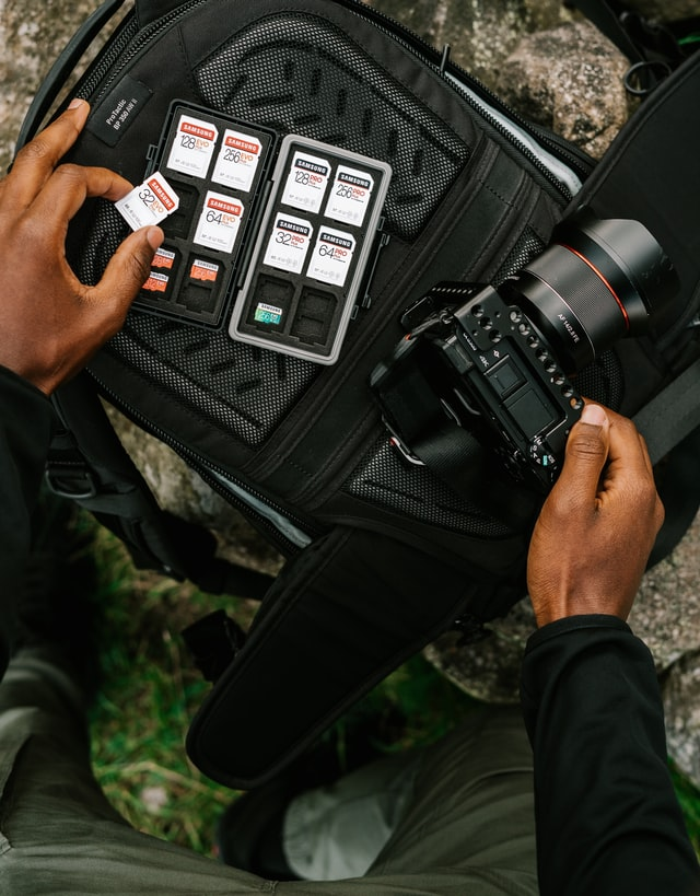 Man inserting SD card in a camera